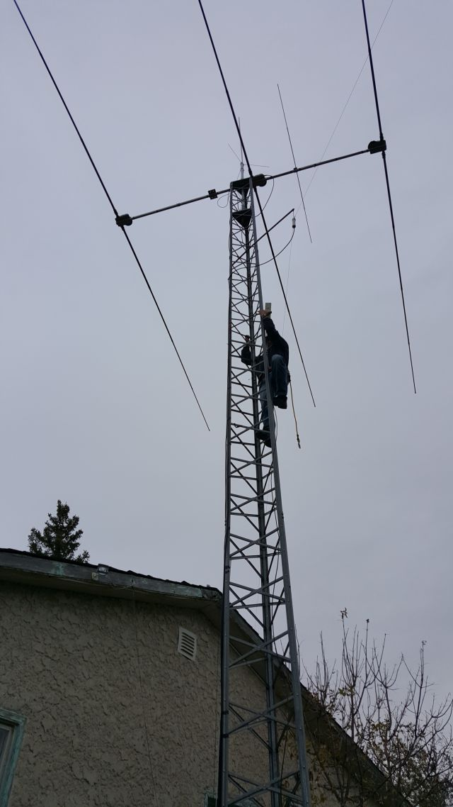 Jim VE4CY tower climbing (nice SteppIR by the way!)