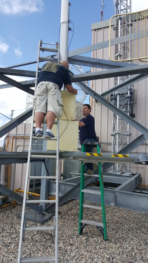 Derek and Colin securing the 5G panels in place .. talk about gain!